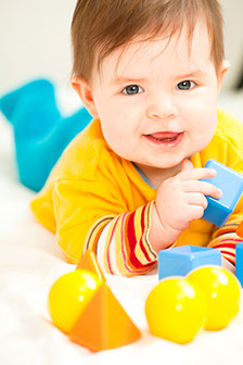 bigstockphoto_happy_baby_girl_playing_with_m_7239659